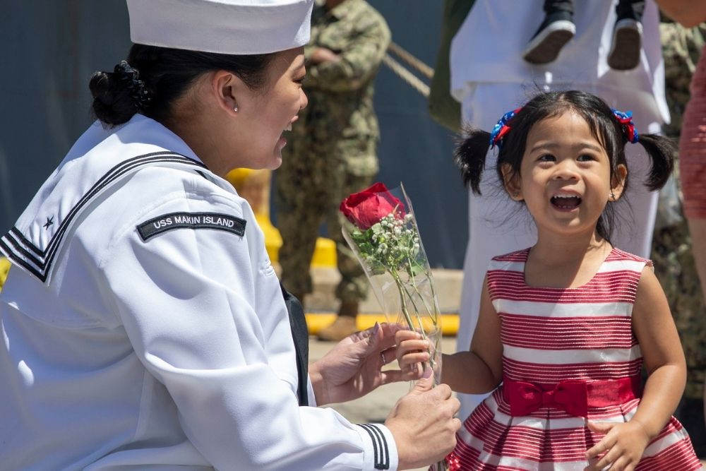 Jasmin Trias greets her family after seven month deployment